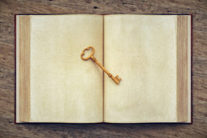 Old Open Book And Skeleton Key